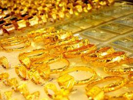 Giá vàng tiếp tục tăng mạnh trên thị trường thế giới, trong nước giảm